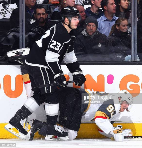 Dustin Brown of the Los Angeles Kings battles against Tomas Nosek of the Vegas Golden Knights in Game Four of the Western Conference First Round...