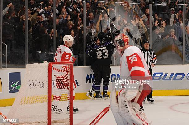 Dustin Brown of the Los Angeles Kings celebrates after a Kings goal against Jimmy Howard of the Detroit Red Wings on January 7 2010 at Staples Center...