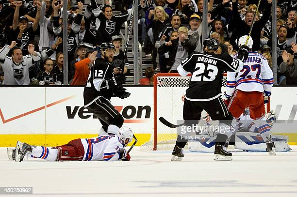 Dustin Brown of the Los Angeles Kings celebrates his double overtime game winner against the New York Rangers during Game Two of the 2014 NHL Stanley...