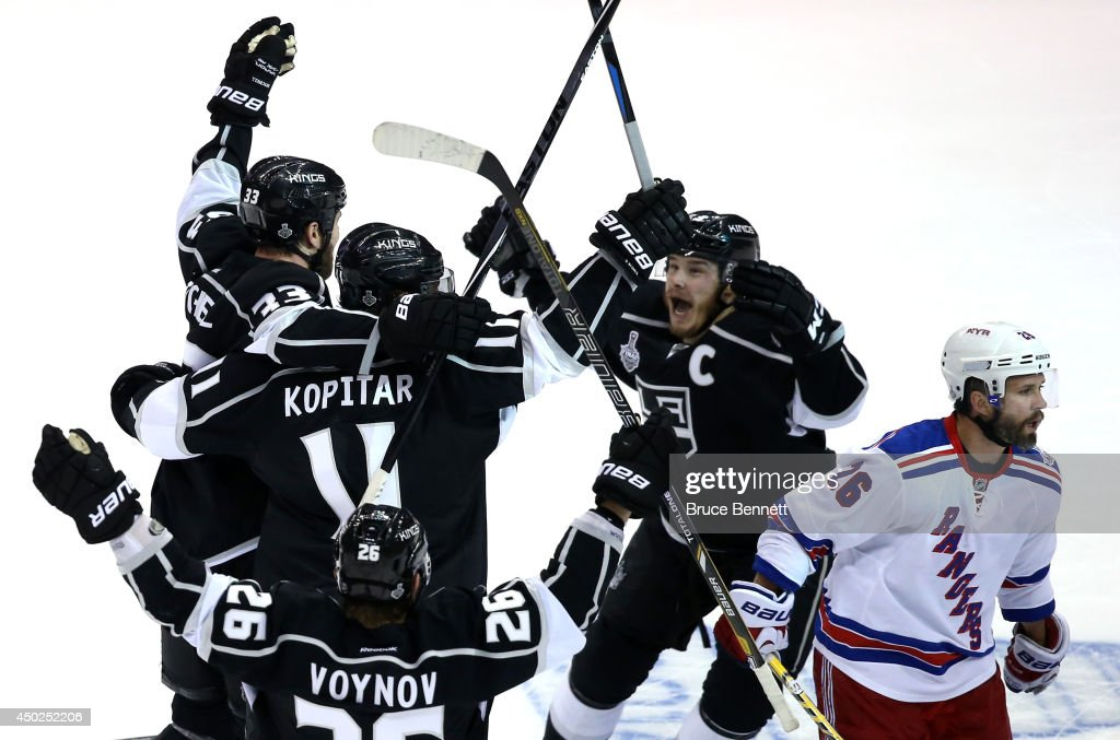Dustin Brown #23 of the Los Angeles Kings celebrates his double overtime game winner as the Kings defeat the New York Rangers 5-4 during Game Two of the 2014 NHL Stanley Cup Final at the Staples Center on June 7, 2014 in Los Angeles, California.
