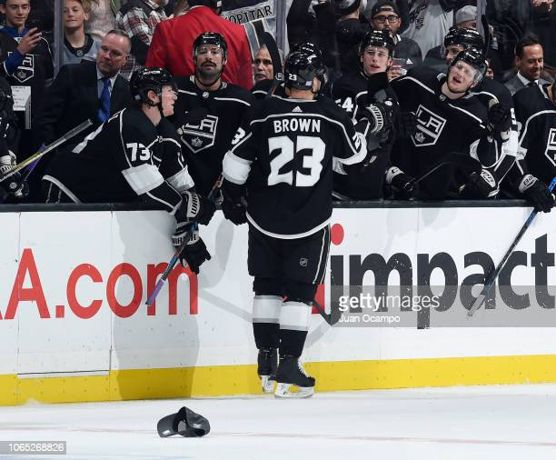 Dustin Brown of the Los Angeles Kings celebrates his hattrick emptynet goal with the bench during the third period of the game against the Edmonton...