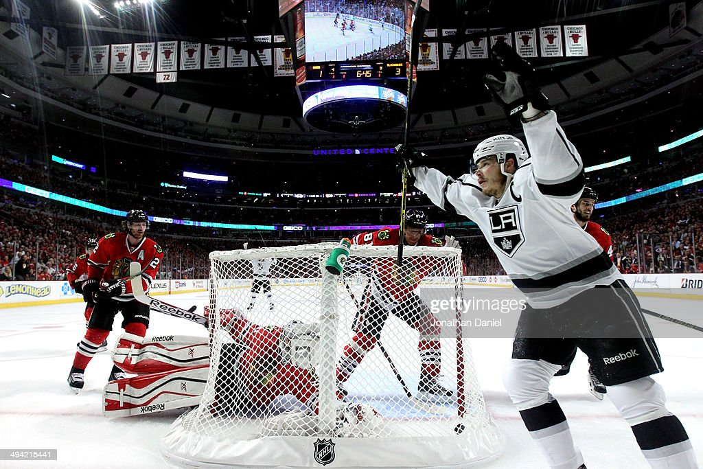 Dustin Brown #23 of the Los Angeles Kings celebrates Marian Gaborik #12 goal against Corey Crawford #50 of the Chicago Blackhawks in the first period during Game Five of the Western Conference Final in the 2014 Stanley Cup Playoffs at United Center on May 28, 2014 in Chicago, Illinois.