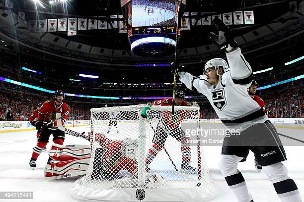 Dustin Brown of the Los Angeles Kings celebrates Marian Gaborik goal against Corey Crawford of the Chicago Blackhawks in the first period during Game...