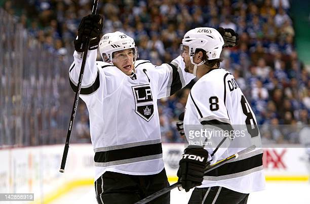 Dustin Brown of the Los Angeles Kings celebrates with Drew Doughty after scoring aginst the Vancouver Canucks during the first period in Game Two of...