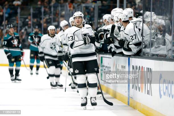 Dustin Brown of the Los Angeles Kings fistbumps teammates after scoring the first goal for the Los Angeles Kings during the first period against the...