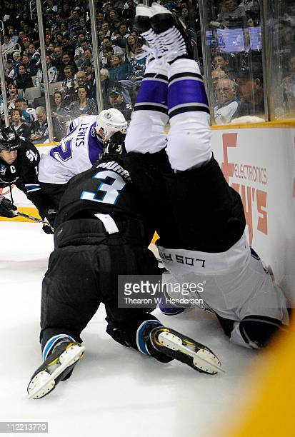 Dustin Brown of the Los Angeles Kings flips over Douglas Murray of the San Jose Sharks in Game One of the Western Conference Quarterfinals during the...