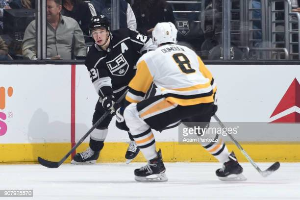 Dustin Brown of the Los Angeles Kings handles the puck against Brian Dumoulin of the Pittsburgh Penguins at STAPLES Center on January 18 2018 in Los...