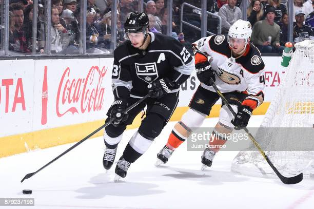 Dustin Brown of the Los Angeles Kings handles the puck against Cam Fowler of the Anaheim Ducks at STAPLES Center on November 25 2017 in Los Angeles...