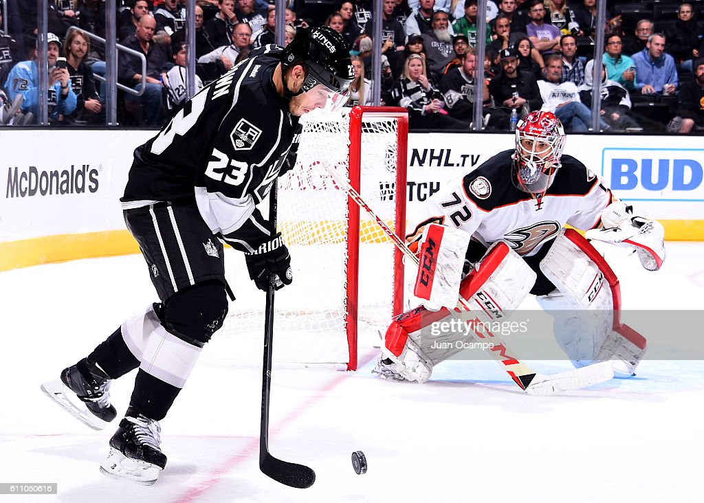 Dustin Brown #23 of the Los Angeles Kings handles the puck as Yann Danis #72 of the Anaheim Ducks defends the net during the game on September 28, 2016 at STAPLES Center in Los Angeles, California.