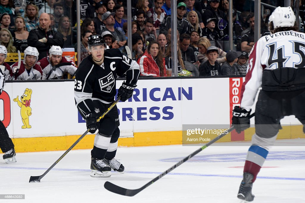 Dustin Brown #23 of the Los Angeles Kings handles the puck during a game against the Colorado Avalanche at STAPLES Center on April 4, 2015 in Los Angeles, California.