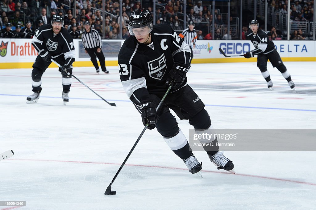 Dustin Brown #23 of the Los Angeles Kings handles the puck during a game against the Arizona Coyotes at STAPLES Center on September 22, 2015 in Los Angeles, California.