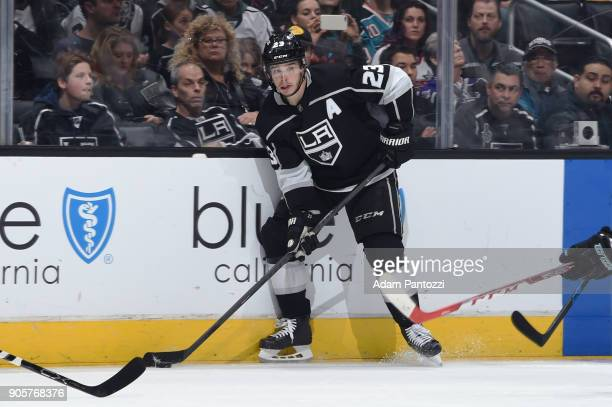 Dustin Brown of the Los Angeles Kings handles the puck during a game against the San Jose Sharks at STAPLES Center on January 15 2018 in Los Angeles...