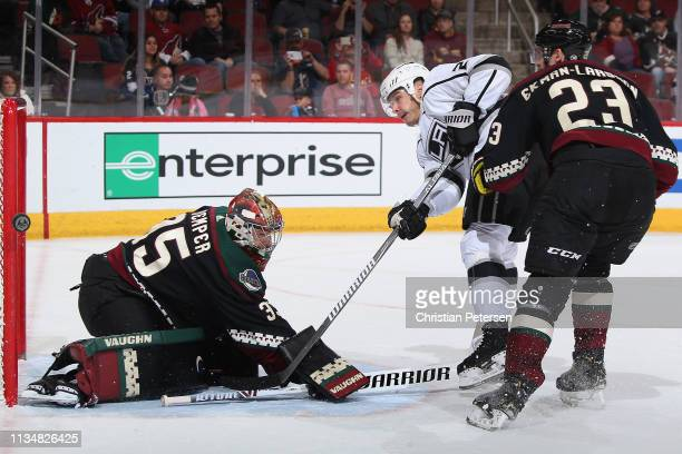 Dustin Brown of the Los Angeles Kings hits the post with a shot behind goaltender Darcy Kuemper of the Arizona Coyotes during the third period of the...