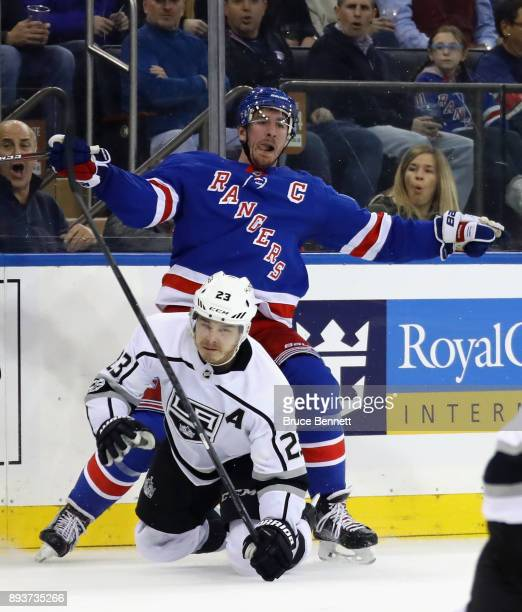 Dustin Brown of the Los Angeles Kings is hit by Ryan McDonagh of the New York Rangers at Madison Square Garden on December 15 2017 in New York City...