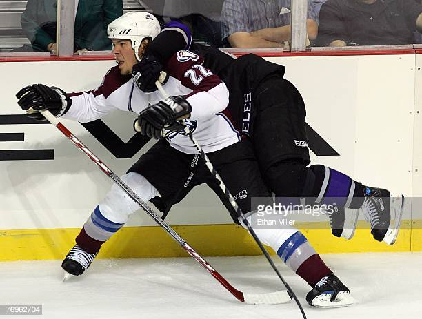 Dustin Brown of the Los Angeles Kings leaps on the back of Scott Hannan of the Colorado Avalanche during the second period of their preseason game at...