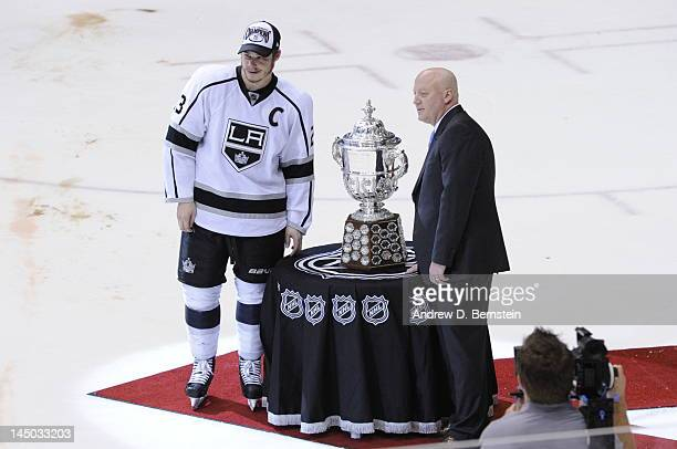 Dustin Brown of the Los Angeles Kings poses with NHL Deputy Commissioner Bill Daly as he presents the Clarence S Campbell Bowl to the Los Angeles...