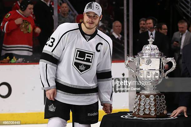 Dustin Brown of the Los Angeles Kings poses with the Clarence S Campbell Bowl after defeating the Chicago Blackhawks 5 to 4 in overtime in Game Seven...