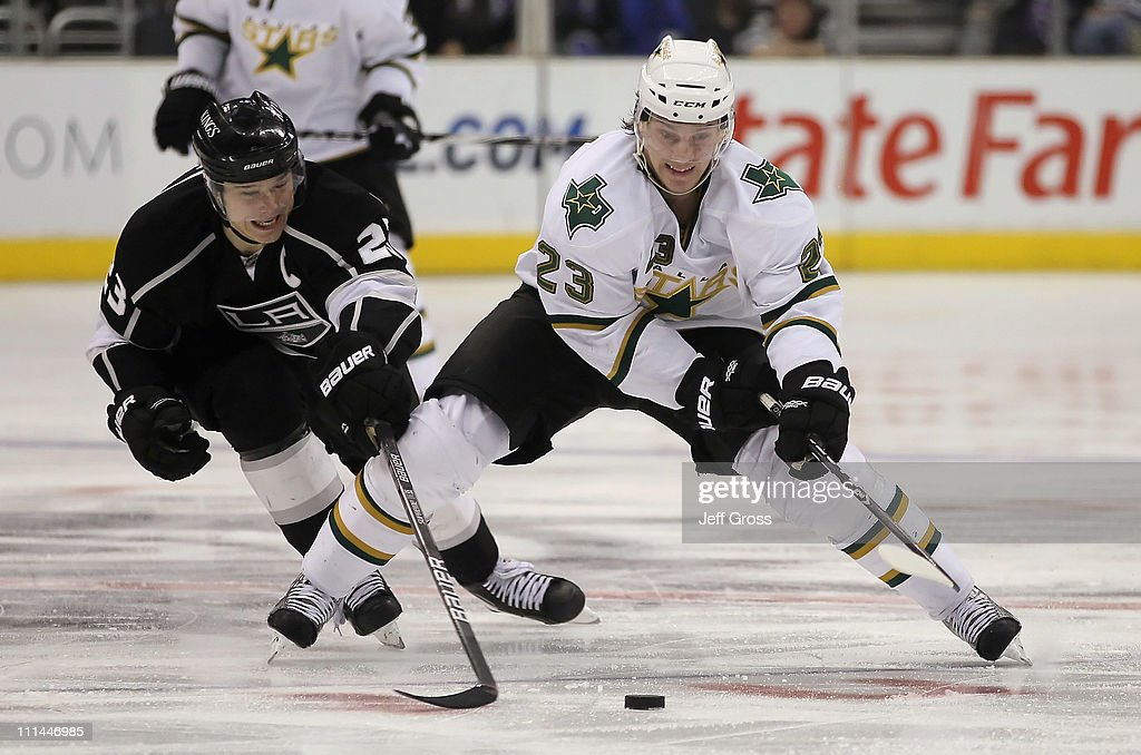 Dustin Brown #23 of the Los Angeles Kings pursues Tom Wandell #23 of the Dallas Stars for the puck in the third period at Staples Center on April 2, 2011 in Los Angeles, California. The Kings defeated the Dallas Stars 3-1.