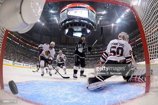 Dustin Brown of the Los Angeles Kings reacts after a goal against Corey Crawford of the Chicago Blackhawks in Game Three of the Western Conference...