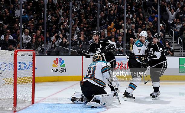 Dustin Brown of the Los Angeles Kings reacts after a Kings goal against the San Jose Sharks in Game Five of the Western Conference Semifinals during...