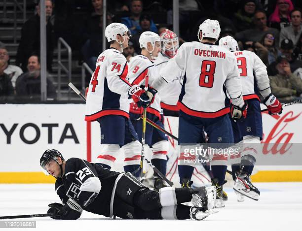 Dustin Brown of the Los Angeles Kings reacts as the Washington Capitals celebrate an empty net goal during the third period in a 3-1 Capitals win at...
