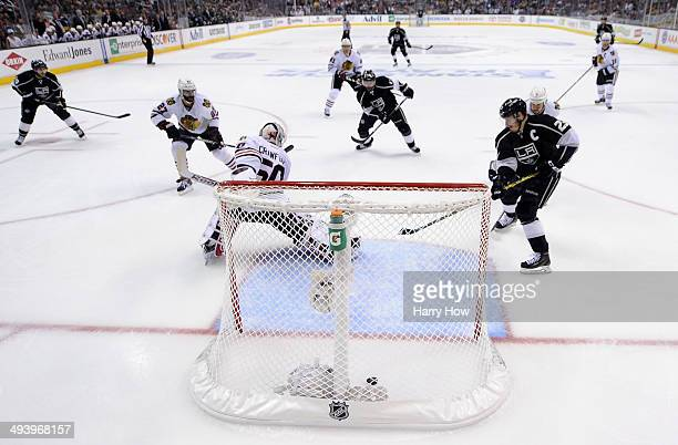 Dustin Brown of the Los Angeles Kings scores a goal in the first period past goaltender Corey Crawford of the Chicago Blackhawks in Game Four of the...