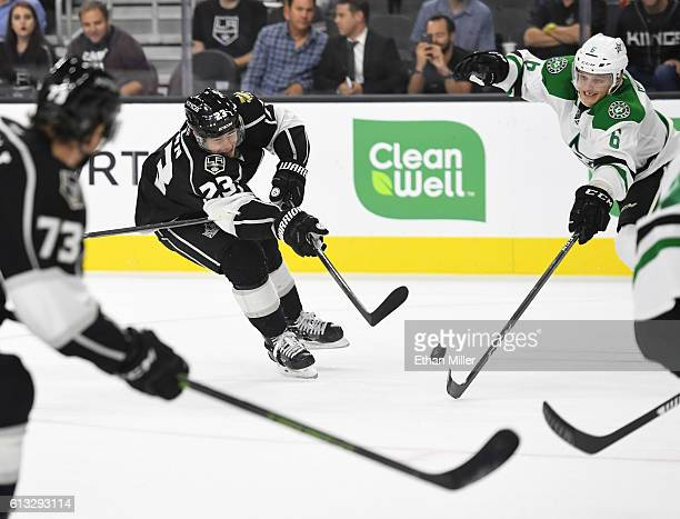 Dustin Brown of the Los Angeles Kings shoots against Julius Honka of the Dallas Stars during their preseason game at TMobile Arena on October 7 2016...