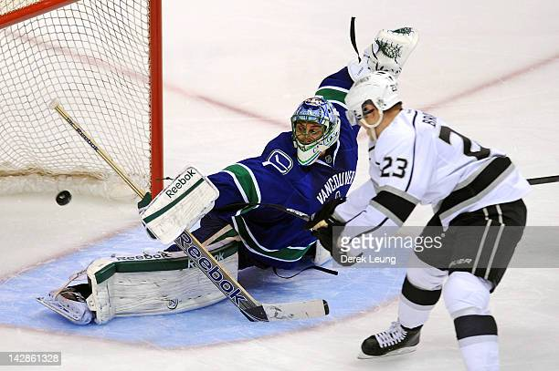 Dustin Brown of the Los Angeles Kings shoots the puck past Roberto Luongo of the Vancouver Canucks in Game Two of the Western Conference...