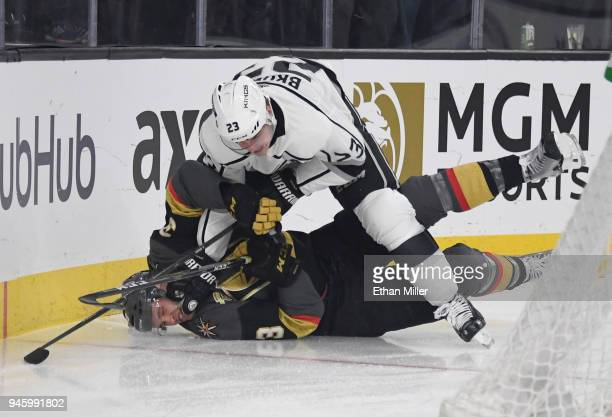 Dustin Brown of the Los Angeles Kings shoves Brayden McNabb of the Vegas Golden Knights down on the ice in the first period of Game Two of the...
