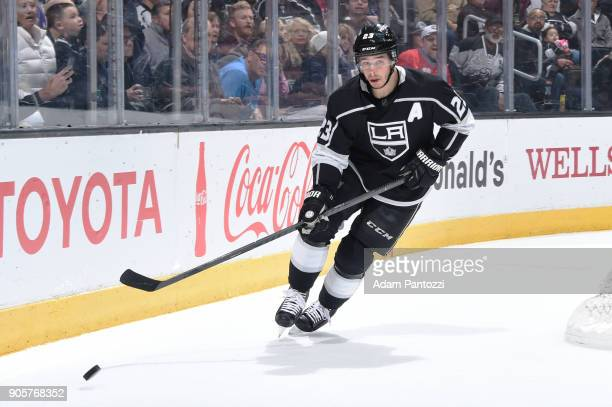 Dustin Brown of the Los Angeles Kings skates after the puck during a game against the San Jose Sharks at STAPLES Center on January 15 2018 in Los...