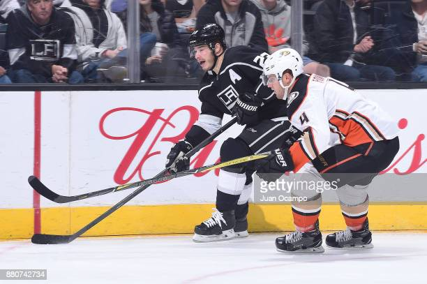 Dustin Brown of the Los Angeles Kings skates against Cam Fowler of the Anaheim Ducks at STAPLES Center on November 25 2017 in Los Angeles California