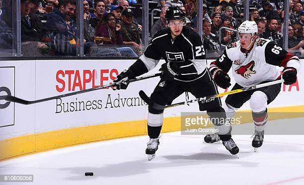 Dustin Brown of the Los Angeles Kings skates with the puck against Kyle Wood of the Arizona Coyotes on September 26 2016 at Staples Center in Los...