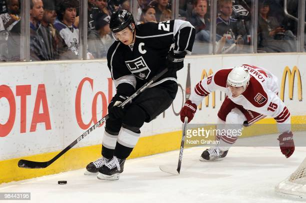 Dustin Brown of the Los Angeles Kings skates with the puck against Matthew Lombardi of the Phoenix Coyotes on April 8 2010 at Staples Center in Los...