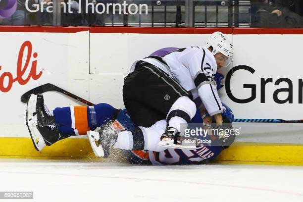 Dustin Brown of the Los Angeles Kings takes Casey Cizikas of the New York Islanders to the ice during the third period at Barclays Center on December...