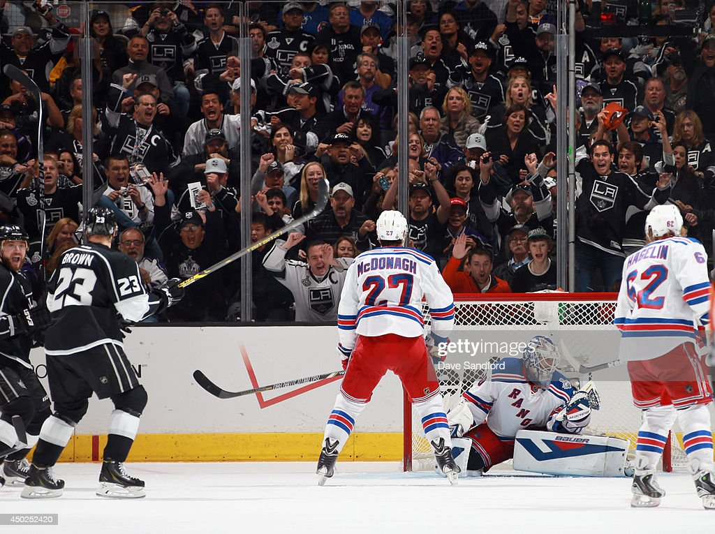 Dustin Brown #23 of the Los Angeles Kings watches as the puck gets past goaltender Henrik Lundqvist #30 on a shot in the overtime to defeat the New York Rangers 5-4 in Game Two of the 2014 Stanley Cup Final at Staples Center on June 7, 2014 in Los Angeles, California.