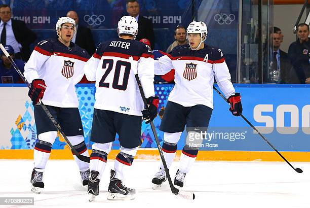 Dustin Brown of the United States celebrates with teammates Ryan McDonagh and Ryan Suter of the United States after scoring his team's second goal in...
