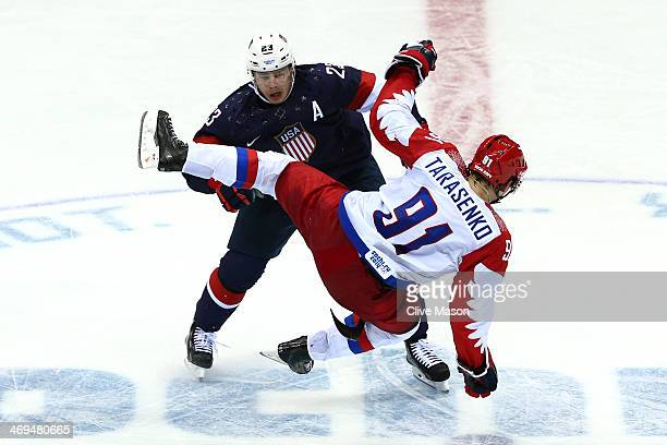 Dustin Brown of the United States collides wih Vladimir Tarasenko of Russia during the Men's Ice Hockey Preliminary Round Group A game on day eight...