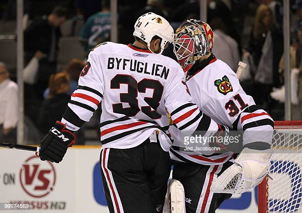 Dustin Byfuglien and goaltender Antti Niemi of the Chicago Blackhawks celebrate the Blackhawks 42 victory against the San Jose Sharks in Game Two of...