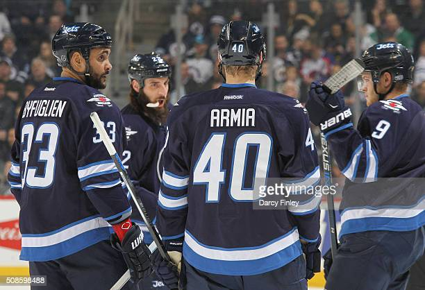 Dustin Byfuglien Chris Thorburn Joel Armia and Andrew Copp of the Winnipeg Jets discuss strategy during a first period stoppage in play against the...