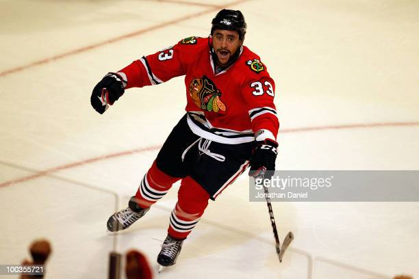 Dustin Byfuglien of the Chicago Blackhawks celebrates his third period goal while taking on the San Jose Sharks in Game Four of the Western...