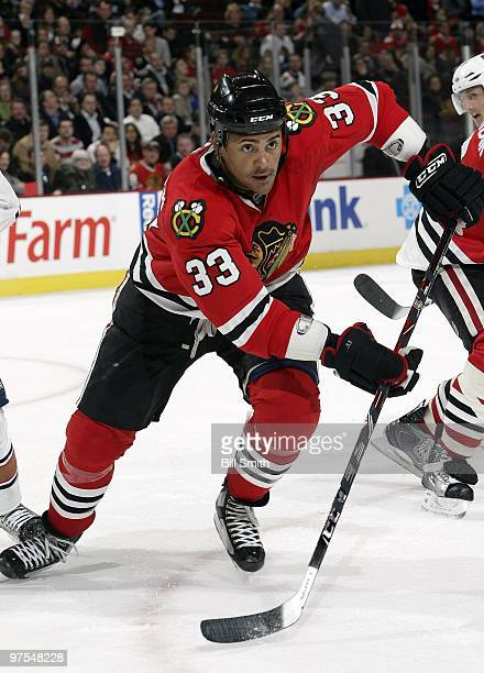 Dustin Byfuglien of the Chicago Blackhawks chases after the puck during a game against the Edmonton Oilers on March 03 2010 at the United Center in...