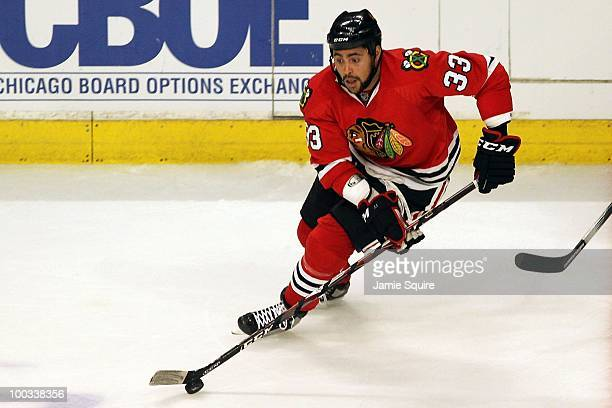 Dustin Byfuglien of the Chicago Blackhawks moves the puck while taking on the San Jose Sharks in Game Three of the Western Conference Finals during...