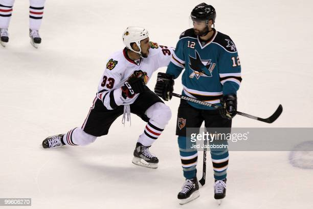 Dustin Byfuglien of the Chicago Blackhawks reacts after scoring the gamewinning goal as Patrick Marleau of the San Jose Sharks looks on in Game One...