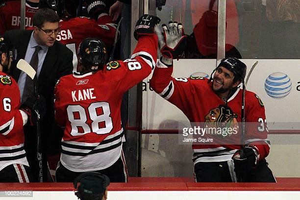 Dustin Byfuglien of the Chicago Blackhawks reacts with teammate Patrick Kane after Byfuglien scores the gamewinning goal in overtime to defeat the...