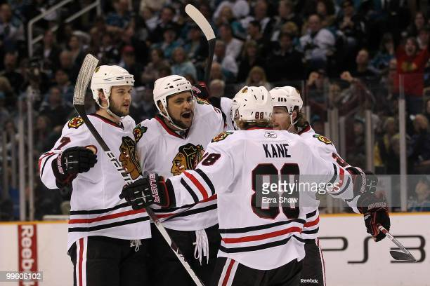 Dustin Byfuglien of the Chicago Blackhawks reacts with teammates after his third period goal against the San Jose Sharks in Game One of the Western...