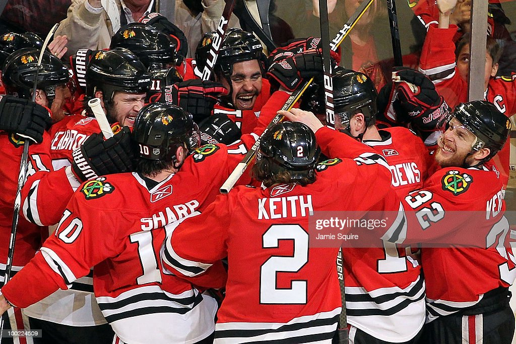 Dustin Byfuglien #33 of the Chicago Blackhawks reacts with teammates after Byfuglien scores the game-winning goal in overtime to defeat the San Jose Sharks 3-2 in Game Three of the Western Conference Finals during the 2010 NHL Stanley Cup Playoffs at the United Center on May 21, 2010 in Chicago, Illinois.
