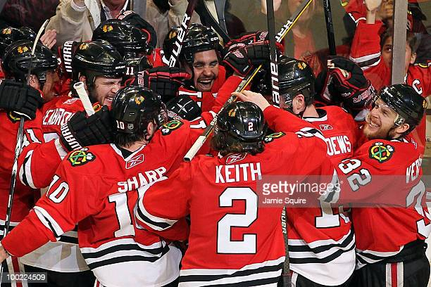 Dustin Byfuglien of the Chicago Blackhawks reacts with teammates after Byfuglien scores the gamewinning goal in overtime to defeat the San Jose...