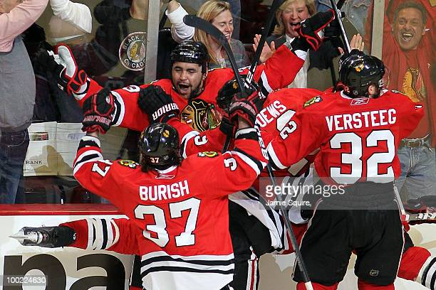 Dustin Byfuglien of the Chicago Blackhawks reacts with teammates Jonathan Toews Adam Burish and Kris Versteeg after Byfuglien scores the gamewinning...