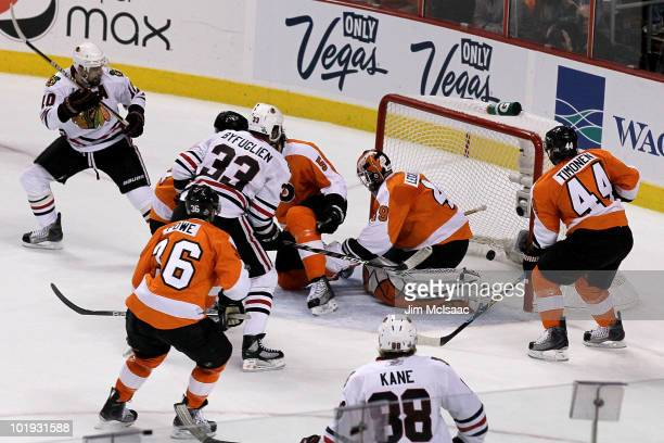 Dustin Byfuglien of the Chicago Blackhawks scores a power play goal in the first period against Michael Leighton of the Philadelphia Flyers in Game...