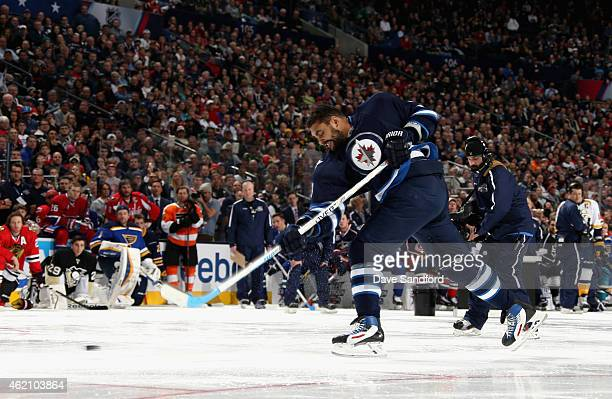 Dustin Byfuglien of the Winnipeg Jets and Team Foligno hits a shot with a speed of 973 mph in the AMP NHL Hardest Shot event of the 2015 Honda NHL...
